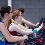 two-women-walking-treadmills